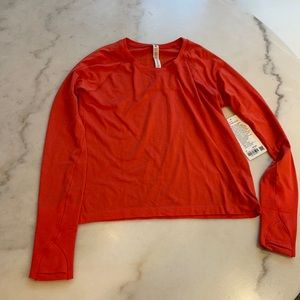 NWT LULULEMON SWIFTLY TECH LS SHIRT 2.0 RACE LENGTH in autumn red. 10